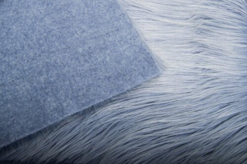 Faux fur by the metre Light Purple faux fur fabric by the metre, long haired in a yeti style – 1568 Cornflower/White